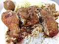 Fried chicken leg with rice from Louti Bento shop.jpg