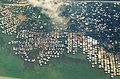 From the air - Stilt houses, Port Moresby. (48641553181).jpg