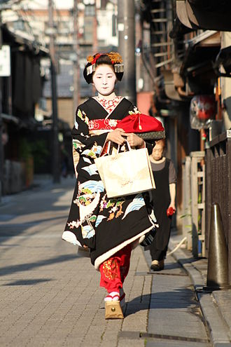 Maiko - Misedashi, a day when a girl becomes maiko. Notice two dangling kanzashi on the sides of her hairstyle.