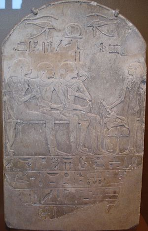 Nymphaea caerulea - Ancient Egyptian funerary stele showing a dead man, named Ba, seated in the center, sniffing a sacred lily, New Kingdom, Dynasty XVIII, circa 1550–1292 BC