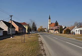 Gajary - Main street with the church
