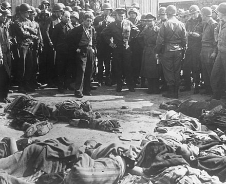 Commander-in-Chief of all Allied Forces, General Dwight D. Eisenhower, witnesses the corpses found at Ohrdruf concentration camp in May 1945. Gen Eisenhower at death camp report crop.jpg