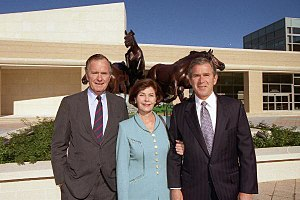 Laura Bush - Laura Bush with husband Governor George W. (right) and father-in-law George H. W. (left) at the dedication of the George Bush Presidential Library, 1997