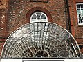 Glass fan above entrance to Elmhurst.jpg
