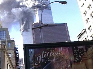 Glitter (film) - The Twin Towers burn behind an advertisement for the film.