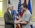 Gordon England congratulates actor Gary Sinise at the Pentagon.jpg