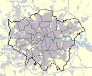 The built up area of London (grey) extends beyond the London boundary. The M25 is also shown.