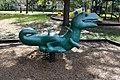 Green outdoor dinosaur spring rocker at John S Taylor Park .JPG