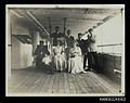 Group of passengers on the deck of a ship (7626159508).jpg