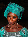 Head of a african woman Gambia with green clothing.jpg