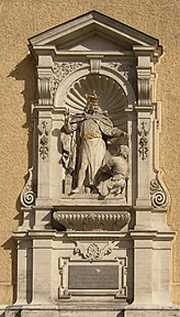 Monument to Henry II on the outside of the Schottenstift