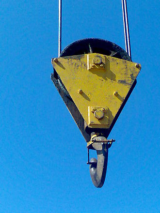 Lifting hook - Lifting hook attached to sheave suspended by wire rope from boom of crane