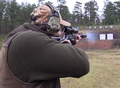 Hunter firing in standing unsupported firing position shooting range Sweden 01.png