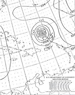 A drawn weather map of Hurricane Dog. The storm is depicted to be north of Puerto Rico. The eastern tip of North Carolina is seen in the top-left portion of the map.