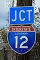 I-12 Sign at Roadside with Weeds (43229523702).jpg