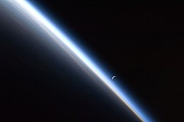 ISS-24 Crescent moon and the thin line of Earth's atmosphere.jpg