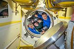 ISS-50 Soyuz MS-02 crew members wave farewell.jpg