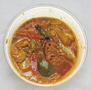South Asian pickles - Indian mixed pickle, containing lotus root, lemon, carrot, green mango, green chilis, and other ingredients