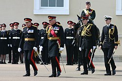 Officer Cadet Wales (standing to attention next to the horse) on parade at Sandhurst, 21 June 2005.