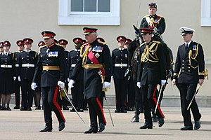 Prince Harry - Officer Cadet Wales (standing to attention next to the horse) on parade at Sandhurst, 21 June 2005