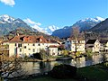 Interlaken West at the River Aare with Mönch and Jungfrau mountains.jpg