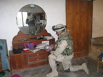 Document Exploitation - Paratroopers of the 82d Airborne Division secure documents after a raid in Iraq