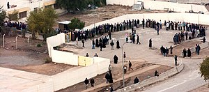 2005 in Iraq - Hundreds of voters line up outside a polling place in Baghdad, 30 January 2005