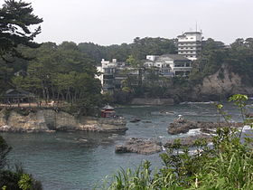 Izura Beach with rebuilt Rokkakudo in 2012.jpg