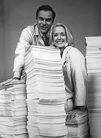 The Doctors (1963 TV series) - James Pritchett (Matt Powers) and Elizabeth Hubbard (Althea Davis) with ten years worth of scripts on the show's tenth anniversary