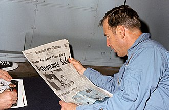 Jim Lovell - Lovell reads a newspaper account of Apollo 13's safe return aboard recovery vessel USS Iwo Jima.
