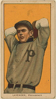 A baseball-card image of a man in an old-style gray baseball jersey and cap with his arms raised above his head