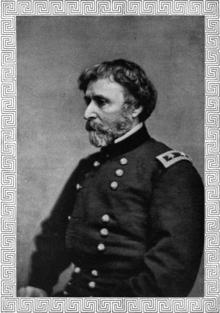 A head and torso photograph of a United States general during the American Civil War.  He is looking to the right, almost in profile.  He has fairly short, dark hair and a short beard that is mostly grey.