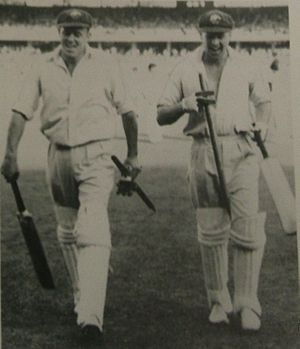 Doug Ring - Ring (right) and Bill Johnston (left) leave the field after their unbroken last wicket stand guided Australia to victory over the West Indies in the Fourth Test at the MCG in 1951–52.