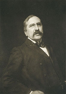 a dark sepia photograph of a man with a moustache