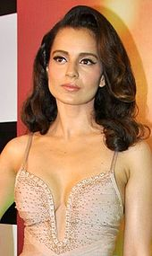 Kangana Ranaut is looking away from the camera