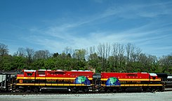 Kansas City Southern de Mexico - 2402 (an EMD GP22ECO-M) and - 401 (an EMD GPTEB-C Slug).jpg
