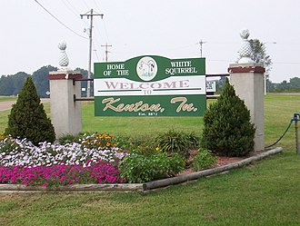 "Tree squirrel - Welcome sign for Kenton, Tennessee, an example of competition for ""White Squirrel Capital""."