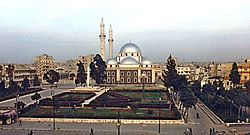 A religious building with multiple silver domes