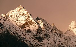 Kinnaur Kailash with Monolithic pillar a 79 feet vertical rock formation that resembles a Shivalinga.jpg