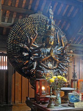 "Buddhism in Vietnam - Statue of Avalokiteśvara, lacquered and gilded wood at the Bút Tháp Temple, dating from the Restored Lê era with inscription ""autumn of the year Bính Thân"" (1656)."