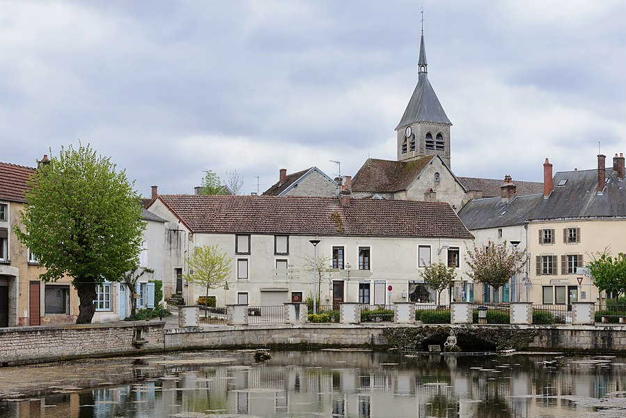 "A view of Laignes, Côte-d'Or department, Burgundy, France, with the church Saint-Didier and the ""resurgence"" of the Laigne river."