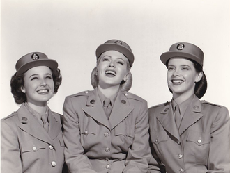 Susan Peters - Peters (right) with Laraine Day (left) and Lana Turner (center) in Keep Your Powder Dry (1945).