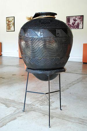 "Museo Estatal de Arte Popular de Oaxaca - Large barro negro ""cantaro"" jar on display at the museum"