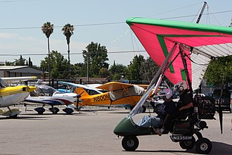 Light-sport aircraft - Three types of Light Sport Aircraft. In the foreground, an E-LSA Antares USA Ranger weight-shift control trike. In the background, an S-LSA Evektor SportStar and an L-LSA Zlin Aviation Savage Cub.