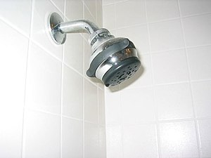 English: Low flow showerheads reduce the amoun...