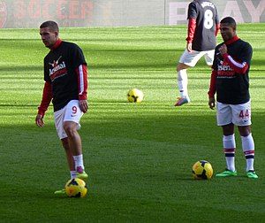 Lukas Podolski - Podolski warming up with Serge Gnabry before their Premier League match against Sunderland in 2014