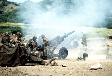 M102 howitzers of 320th Field Artillery Regiment firing during the 1983 invasion of Grenada M102 howitzers during Operation Urgent Fury.jpg