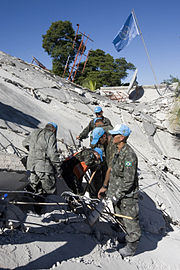 MINUSTAH peacekeepers continue to work to find survivors after an earthquake (12 january 2010)
