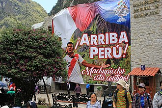 Peru national football team - Giant poster in the town below Machu Picchu, featuring Edison Flores and the chant ¡Arriba Perú!