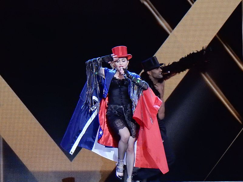 https://upload.wikimedia.org/wikipedia/commons/thumb/b/b6/Madonna_-_Rebel_Heart_Tour_2015_-_Paris_1_%2824036597741%29.jpg/800px-Madonna_-_Rebel_Heart_Tour_2015_-_Paris_1_%2824036597741%29.jpg